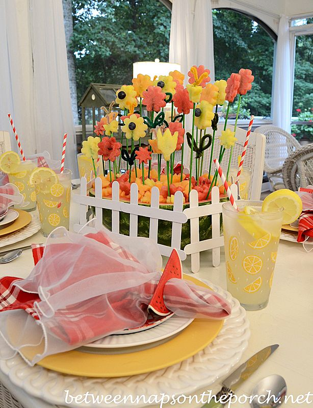 Summer Tablescape with a Carved Watermelon Centerpiece... aren't the flowers so cute?  http://betweennapsontheporch.net/carved-watermelon-centerpiece-create-a-garden/