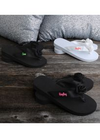 Personalized flip flops for your bridesmaid's will show off their pedicures in style! These David's Bridal exclusive flip flops make a truly unique gift that she'll use over and over. Features and Facts:  Personalize with your choice of David's Bridal exclusive thread colors to match your bridesmaid dress colors.  Personalize with up to 10 characters, including spaces.  Embroidery will be on the right flip flop as shown.  Straps are made from a soft woven polyester for durability.  Sizes: S…