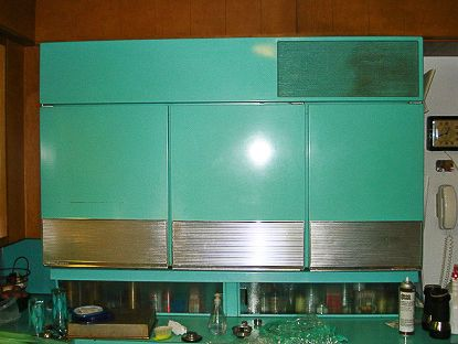 1957 ge refrigerator - i wish you could see the bottom part of the fridge...it has cabinets and pull out refridgerated drawers.my new mission in life....i must find one of these