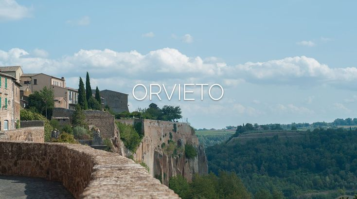 The Hill Town of Orvieto rises dramatically amidst volcanic cliffs, a defensive marvel of 16th Century Italian architecture.