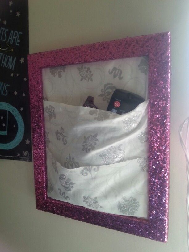 Wall organizer! Just take any frame, then wrap and layer fabric around the back piece to create pockets! Instant glasses and remote holder!