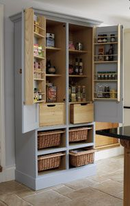 Free-Standing Larder:    Free standing kitchen pantry cabinet with 4 sliding wicker baskets, 2 solid oak bread drawers and herb racks.