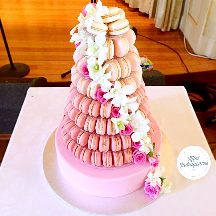 Pink ombré macaron cake tower as an alternative to a wedding cake. Loving the cascading flowers!