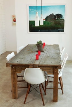Eames chair, rustic table. Love this combo.
