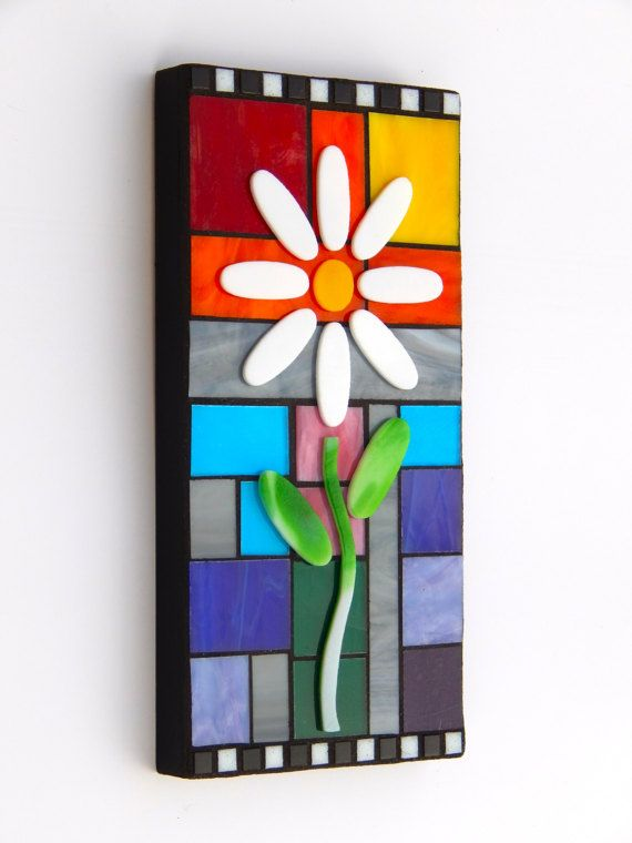Each mosaic piece that I create is unique and made with individually hand cut pieces of stained glass. The stained glass pieces are carefully cut and put into place by me, one-by-one. Once completed, the entire piece is then grouted, cured for several days and is then sealed with two coats of grout sealant. Each piece is a one-of-a-kind work and will last for many years to come. I take great pride in my craft and it shows through to you in each finished piece. Mosaic Art Wall Panel, Bloom…