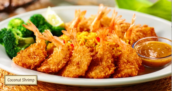The beautiful Coconut Shrimp platter from Bahama Breeze. Mhhh.. noms!    - Value hint: M-F visit during Happy Hour! Only $5.00 for 8 shrimps.. add an order of rice, and you can get out with a great meal for less then $8.00!
