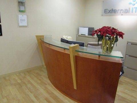 Used Curved Reception Station This curved, veneer, a-linear reception desk  features