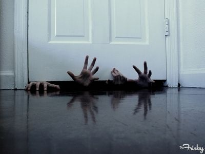 scary hands coming from under the door