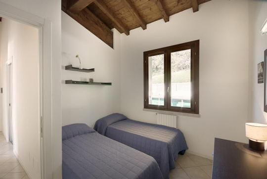Borgo Oriolo is a sophisticated private residence with apartments sharing a swimming pool, set in beautiful countryside above Toscolano Maderno, Lake Garda. Italy