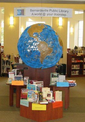 display for traveling to other places? Add suitcases, passports, use books that take place elsewhere