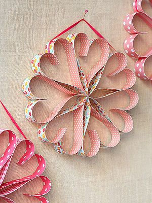 Easy Valentine's Day Paper Heart Wreath with easy DIY instructions.