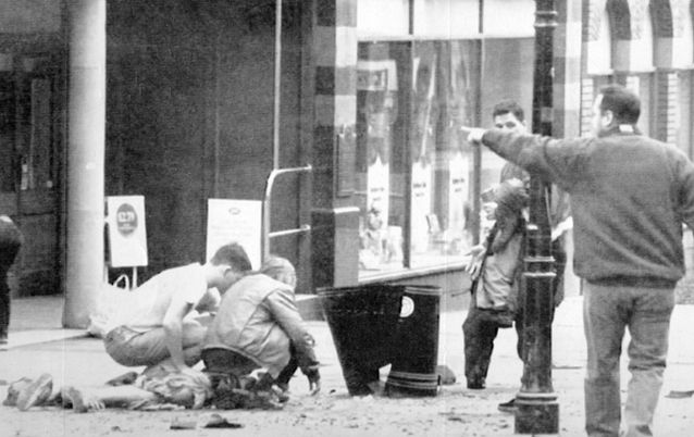 A child lies by a litter bin after an IRA  bomb blast in Warrington town centre 1993