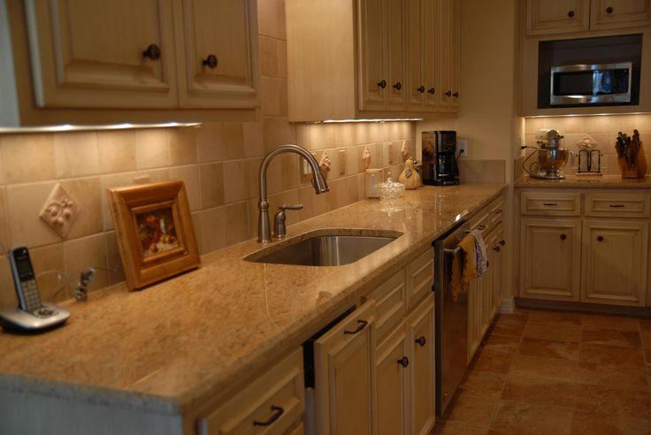 Ivory cabinets with Cocoa glaze and kashmir granite countertops - My dream kitchen is only a few years away! Simple yet elegant. Minus the backsplash tile as I don't know what I am doing with that yet.
