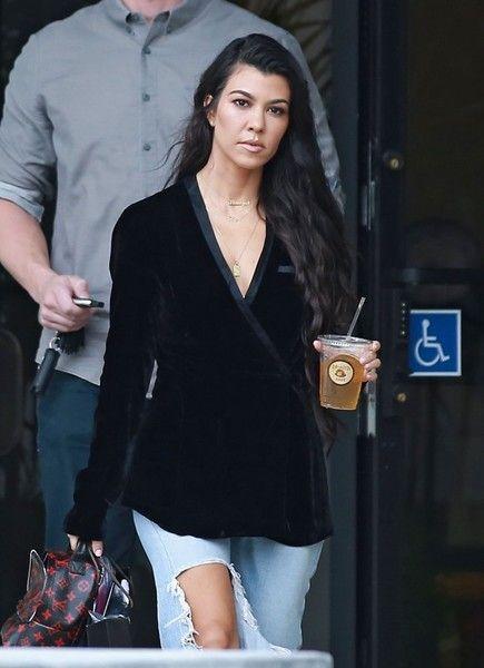 Reality star Kourtney Kardashian is seen leaving a studio with her bodyguard in Los Angeles.