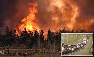 More than 80,000 residents have been ordered to flee Fort McMurray, Alberta as a wildfire whipped by winds engulfed homes and sent ash raining down on residents.