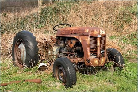 Google Image Result for http://www.featurepics.com/FI/Thumb300/20070425/Old-Rusty-Abandoned-Farm-Tractor-295565.jpg