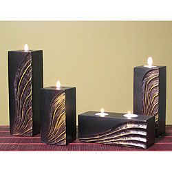 @Overstock.com - Hand-carved Gold Wave Candle Holders (Set of 4) - Featuring a modern wave design, this hand-carved wood candle holder set will add drama to any room. This set of four candles is finished in matte black and accented with gold for added boldness, and they are designed to work with tea light candles.  http://www.overstock.com/Home-Garden/Hand-carved-Gold-Wave-Candle-Holders-Set-of-4/3643869/product.html?CID=214117 $38.49