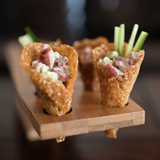 Elegant tuna tartare hors d'oeuvres. Crispy sesame cones filled with diced sushi-grade tuna in a spicy sriracha mayo with ponzu.