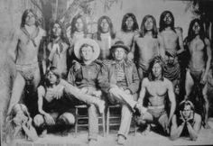 A group of Maricopa Indian warriors with an Anglo cowboy. Arizona