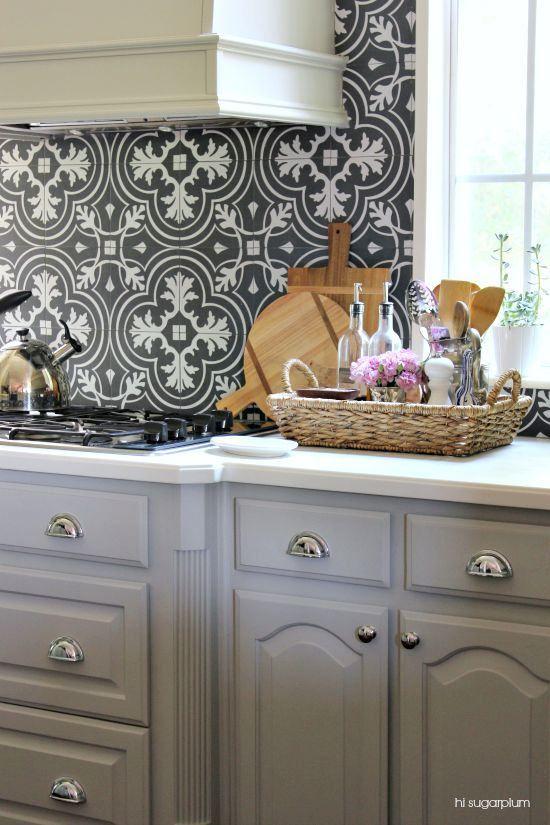 silver gray cabinets, dark gray and white Moroccan tile backsplash, basket on kitchn countertop, silver bin handle