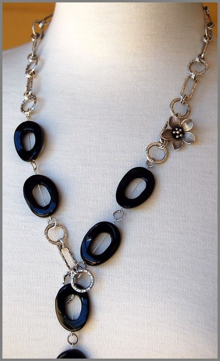 L27: black Onyx hollow ovals and chain with flower detail