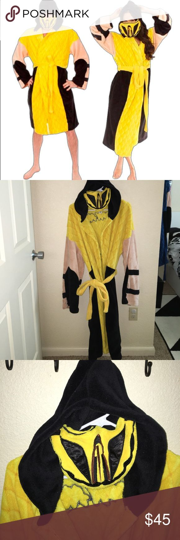 Unisex Mortal Kombat Scorpion Robe Show your love for Mortal Kombat with this awesome scorpion robe! Yellow and black                                                          Hooded                                                                   Detachable Velcro Mask 100% Polyester super comfy, Soft Material.  One Size Fits Most Measures 46 1/2-inches long Unisex Mortal Kombat Intimates & Sleepwear Robes
