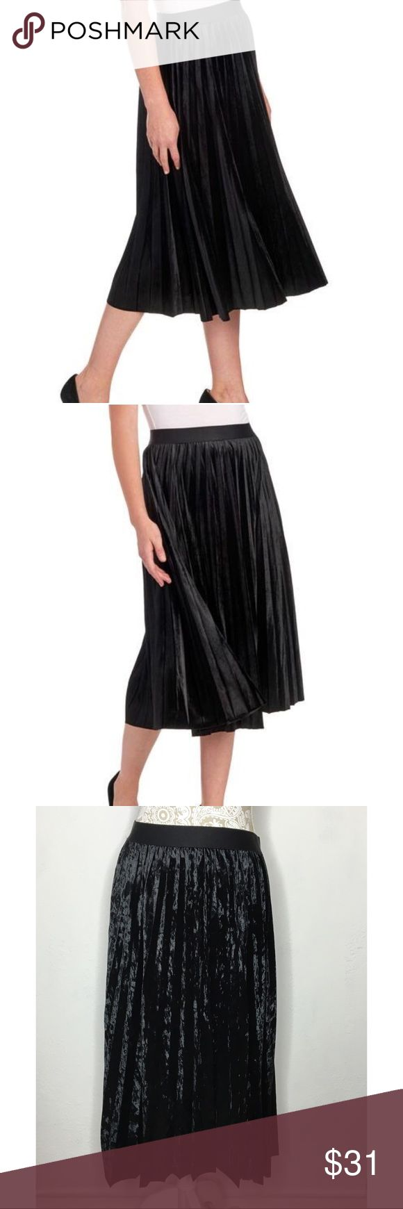 """NWT Max Studio black velvet pleated midi skirt M NWT Max Studio supple textured velvet midi skirt. Asymmetrical hem and tailored with tiny pleats that makes it perfect for work or a holiday soirée. Size Medium  Pull on. Length: 30"""" 93% Polyester 7%spandex.  Hand wash; line dry. Brand new with tags. 98$ retail. #max #skirt #black #velvet #new #nwt #midi #career #formal #holiday #pleats #stretch ❌no trades❌ Max Studio Skirts Midi"""