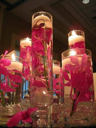 DIY - Place water & your favorite flowers inside clear cylinder vases of different sizes.  Add a floating candle.: Centerpiece Ideas, Floating Candles, Flower Centerpieces, Wedding Ideas, Submerged Flowers, Table, Wedding Centerpieces, Center Pieces