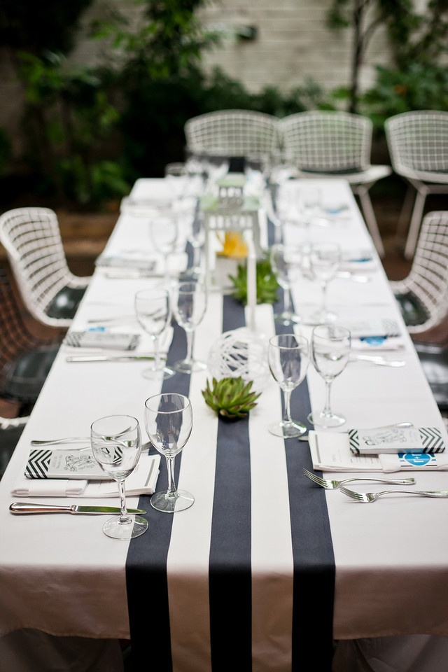 cute ideas for party or shower. Ribbons down the middle of a simple table cloth.