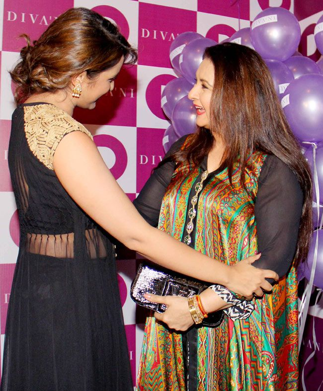 Parineeti Chopra greets Poonam Dhillon at the the opening of the ethnic wear label Diva'ni in Santacruz. #Style #Bollywood #Fashion #Beauty