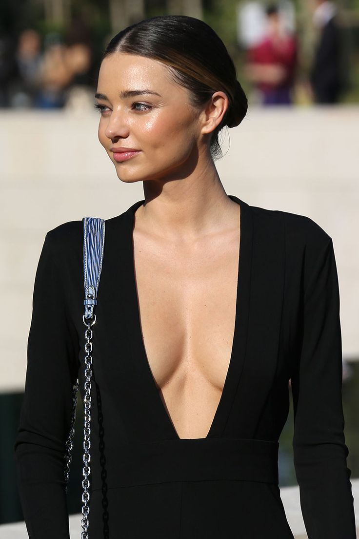 The Best Beauty Looks of the Week - October 2, 2014 - Elle Miranda Kerr at the Louis Vuitton show on 10/1/14 A polished, center-parted bun draws attention to Kerr's glowing skin.