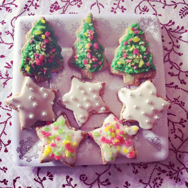 Gingerbread Christmas biscuits decorated with silver cachous and popping candy!