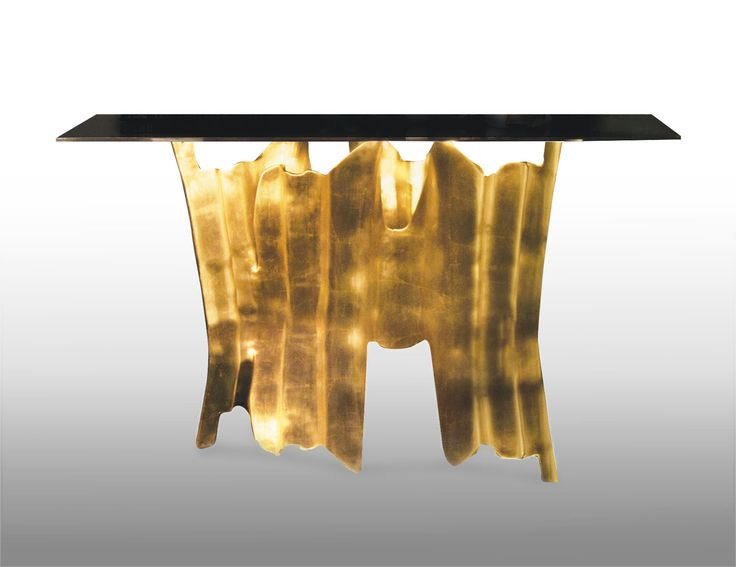 OBSSEDIA console by Koket   Initially it is a console. Then it becomes a console cut from clear glass, the top slightly smoked in bronze. Your eyes begin to wander down, drinking in the rhythmic design of the gold plated aluminum base, following every gold crevice leading down only to head back up; compelling you to continue staring. #console #luxurydesign #interiordesign http://www.bykoket.com/guilty-pleasures/casegoods/obssedia-console.php