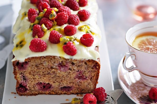 Classic banana cake gets a makeover with tart berries and a fruity topping.