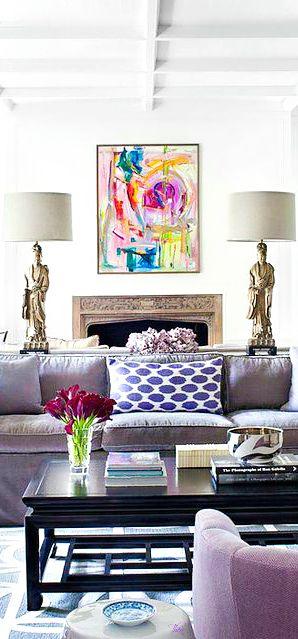 Gray velvet sofa abstract art and asian table lamps white walls in living room burnham design