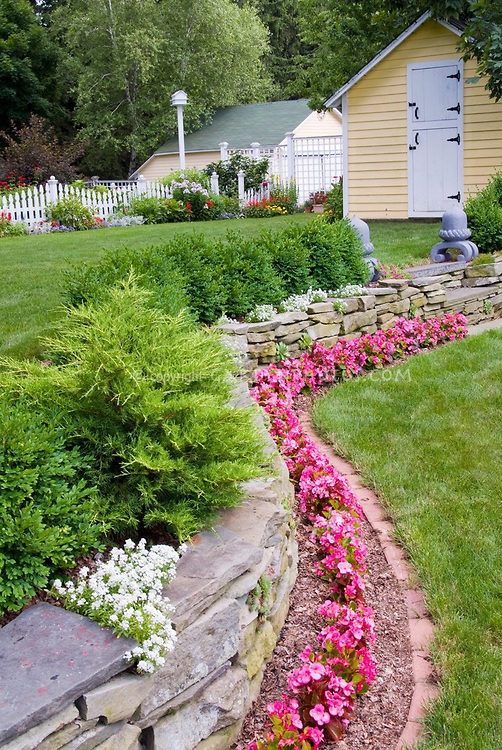 Beautiful backyard landscaping plant flower stock for Beautiful raised beds