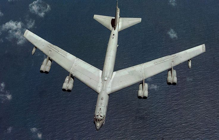 The high aspect ratio wing of a United States Air Force B-52 bomber. DIEGO GARCIA, British Indian Island Territory -- A B-52H Stratofortress from the 96th Bomb Squadron, Barksdale Air Force Base, La., deployed to the 2nd Air Expeditionary Group, Naval Station Diego Garcia, drops away after air refueling. Date 	9 December 1998