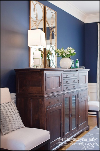 Dining room with navy blue wall and bench made side board