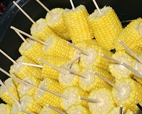 Cooler Corn (Obviously make sure you are using a clean cooler)  -Place washed and shucked ears of corn (no specific # required)  -Pour two kettles of boiling water over the corn  -Close lid and leave for 30 minutes. Ta da! You have perfectly cooked corn on the cob!