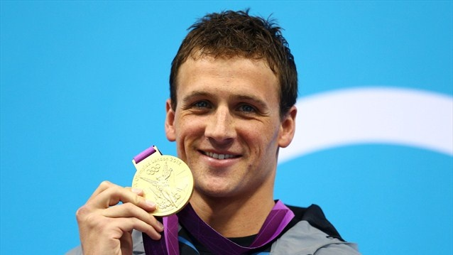 ... Ryan Lochte poses on the podium with the gold medal after winning the men's 400m individual medley