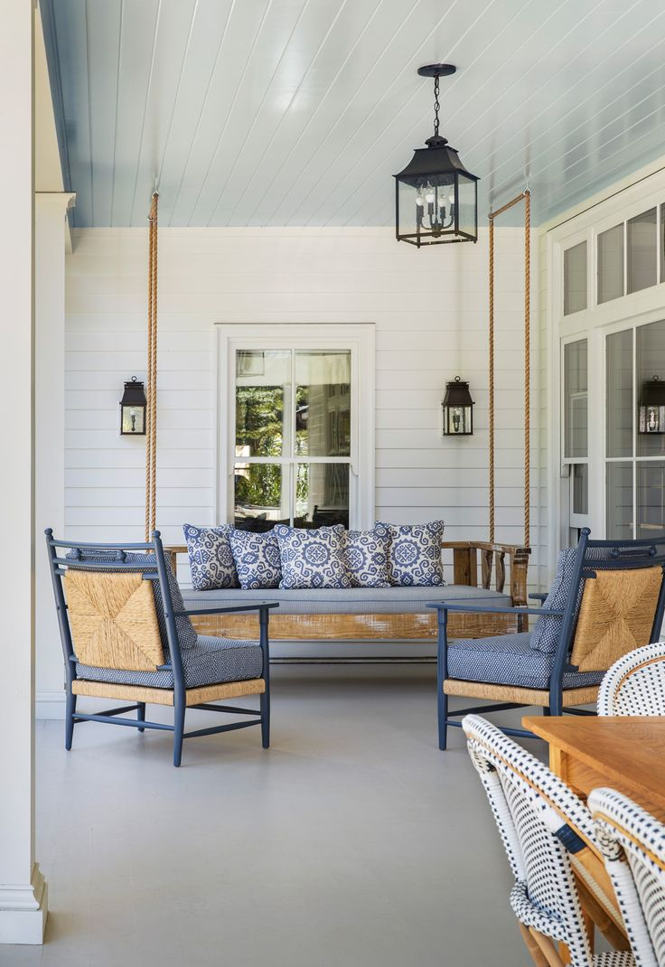 """A Charleston porch. The blue ceiling is a tradition that """" keeps evil spirits away from one's door"""" !"""