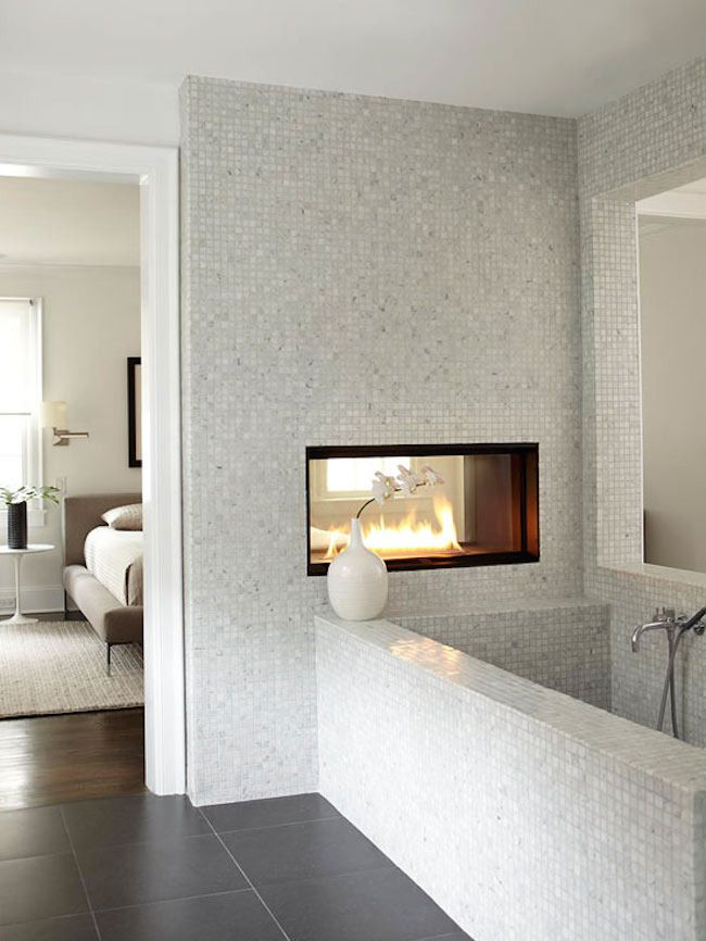Bedroom Bathroom with Built In Modern Fireplace containing: Chrome Finished Tub Faucet with Built In Bathtub also White Flower Vase plus Mosaic Wall Tile together with Gray Tile Flooring