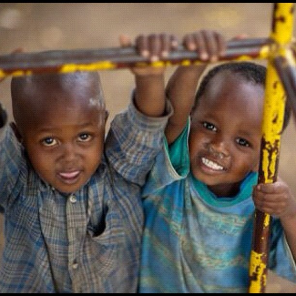 Friendship even brings smiles to the most challenging circumstances. | #poverty #friends #children #tanzania