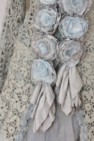 Cashmere roses - made from salvaged cashmere sweaters & lace, then sewn onto a scarf. So pretty!