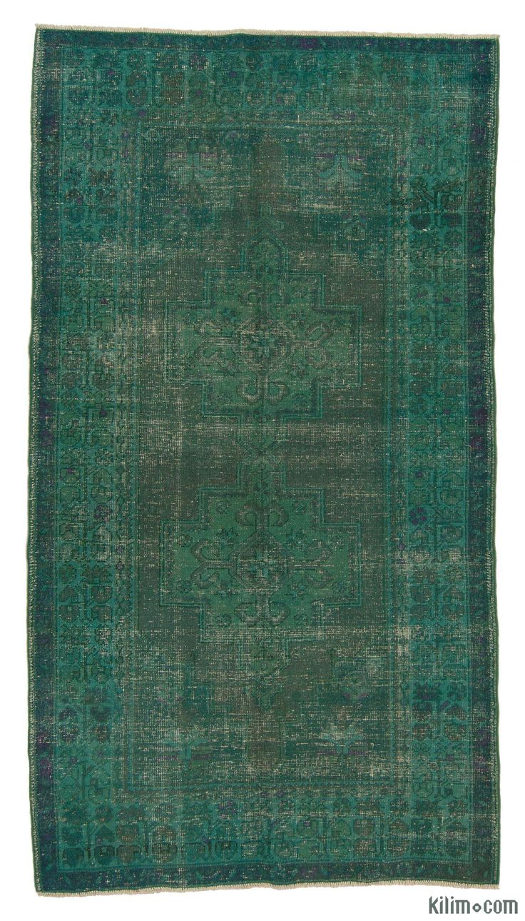 "For a contemporary look with abstract appeal, this green over-dyed rug is skillfully crafted by the revitalization of a hand knotted vintage Turkish rug. Made from wool on cotton, this ""distressed"" rug measures 132 cm x 245 cm. The process in creating these works of art begins by shearing to lower the pile and to help ""distress"" them. They then undergo a series of processes to remove the color. They are now ready to be dyed in one color, a stage that can be repeated several times to reach t…"