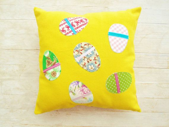 Bright and happy yellow small pillow case with six applique Easter eggs with satin ribbon finishing.  Back side is made of floral yellow, orange and green cotton with orange zipper.  Size about: 30 x 30 cm / 12 x 12.  Note: Inner pillow is not included.  For care: Machine wash cold or hand wash with suitable detergent, ironing hot.  See also other pillows:  https://www.etsy.com/listing/164719881/pillow-case-decorative-throw-pillow?ref=shop_home_active_1  htt...