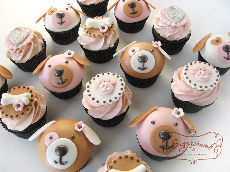 This cupcake set was made for a little girl turning 2 who loves dogs. Chocolate cupcakes with pink vanilla buttercream, decorated with fondant bones, paw prints, and monogrammed dog tags.