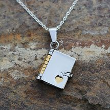Kelli I found your next necklace Book necklace with three movable golden pages inside, on a silver chain.