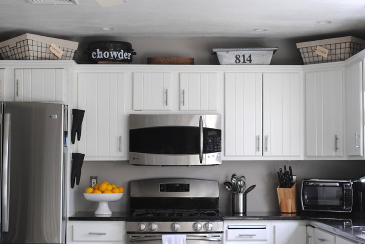 kitchen cabinets black baskets for above the cabinets with labels so you don t 2892
