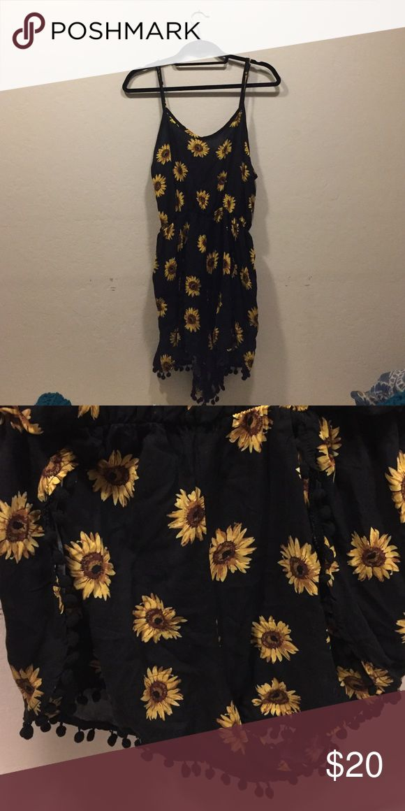 Sunflower print romper Fit with adjustable straps that can be un-clipped in the back. Other